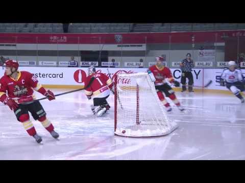 Evgeny Grachyov blasts a puck through the net