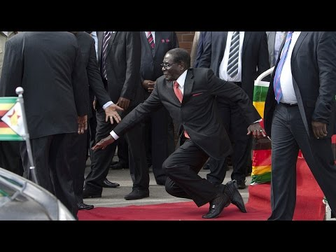 WATCH: Robert Mugabe falls down steps in Harare