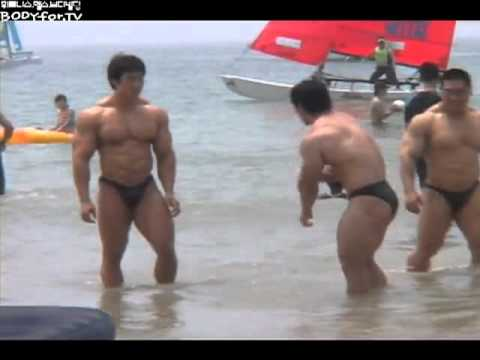 Three hot bodybuilders at the beach
