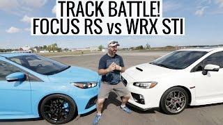TRACK BATTLE! Ford Focus RS vs Subaru WRX STI