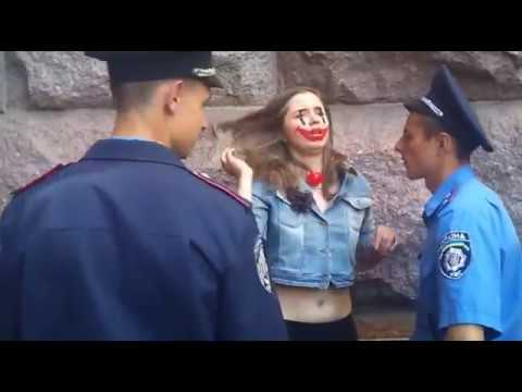 Ukrainian FEMEN feminist activist detained by police in central Kyiv at Europe Day