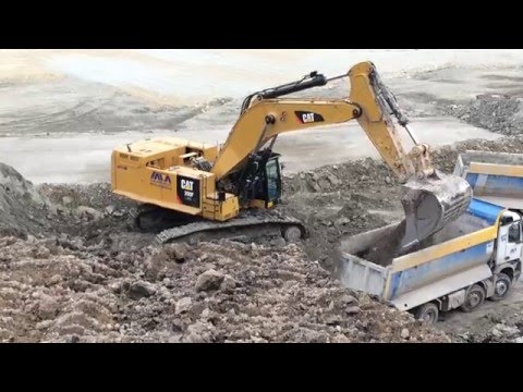 Caterpillar 390F Excavator Loading Mercedes Arocs Trucks