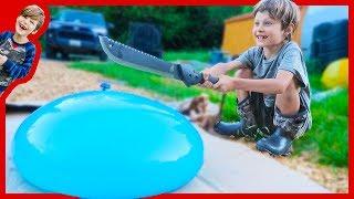 Machete Vs  Giant Water Balloon in Slow Motion