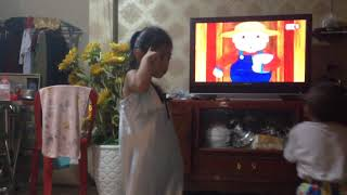 Lovely Kid Dancing Following TV Show