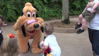 Super Excited child meets Pluto at Walt DisneyWorld