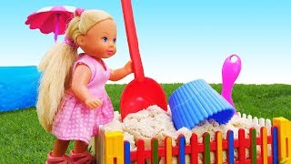 Barbie baby doll plays on the playground