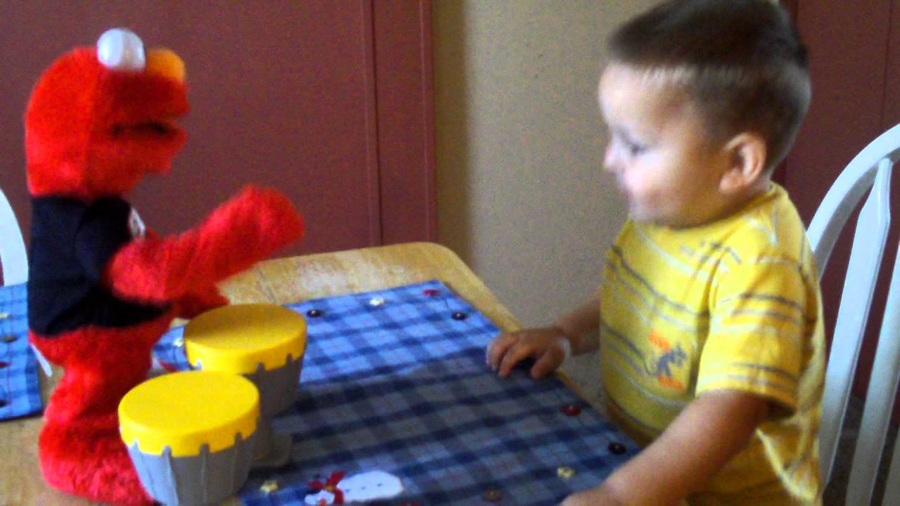 Baby bryson playing amp dancing with singing elmo so cute amp funny