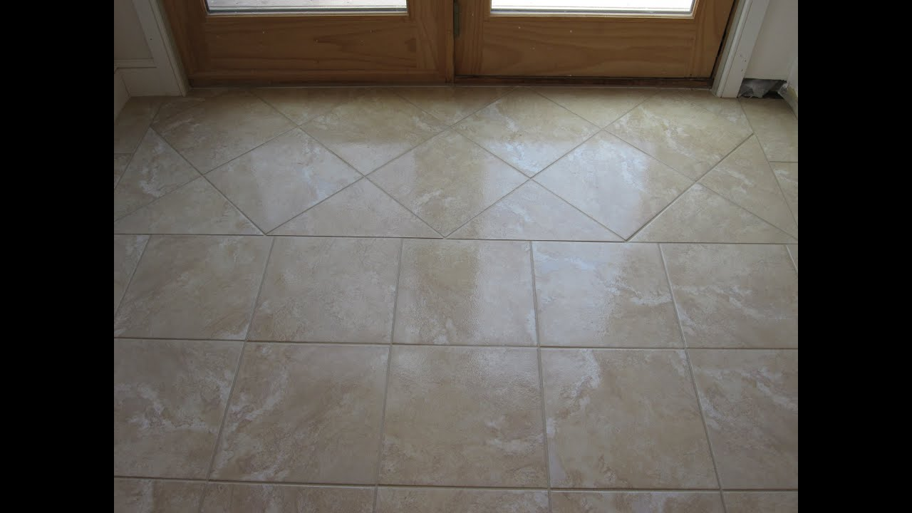 Ceramic tile basement floor part 1 youtube for What is the best flooring for a basement
