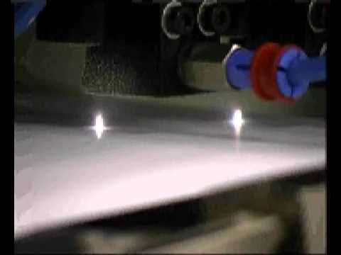 High speed paper/plastic perforation using carbon dioxide lasers