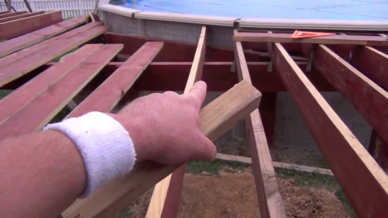 Pool deck building setting joists youtube for How to build a platform deck for above ground pool