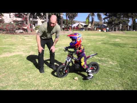 Kid Riding Oset 12.5 Electric Trials Bike