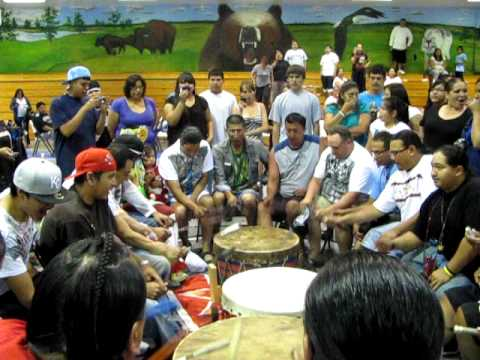 The Smoke River drum group sing a song given to the Winnebagos in appreciation for their help over the holiday weekend. Joining them is Standing Eagle, Omaha...