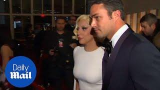 Lady Gaga cuddles up to her boyfriend Taylor Kinney - Daily Mail