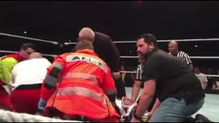 Chris Jericho is examined by medical personnel after suffering a vicious attack at the hands of Kevi