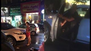 Vợ mang bụng bầu chặn đầu xe oto đang chở chồng và bồ nhí giữa trời mưa râm