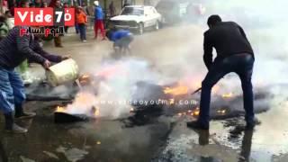 بالفيديو.. أهالى شارع التعاون يخمدون نارًا أشعلها الإخوان فى الإطارات