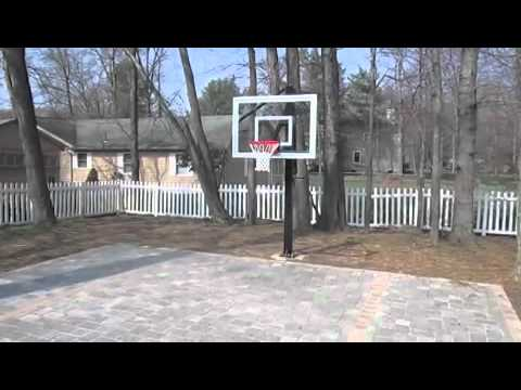 Brick paver backyard basketball court youtube for Homemade basketball court