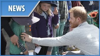 Prince Harry gives shy boy a tummy tickle