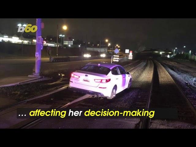 Woman Drives Car Onto Train Tracks And The Reason