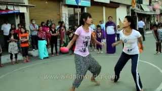 Girls fight it out - Balloon bursting game during Yaoshang Festival in Manipur