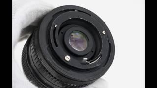 Canon T70 35mm SLR film camera + Super Danubia 28mm f/2.8 + Canon FD 70-150mm f/4.5