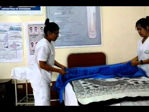 Tendido de cama quirurgico youtube for Cama cerrada
