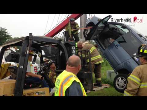 WATCH: Firefighters rescue elderly woman trapped in vehicle suspended on utility pole guy wire