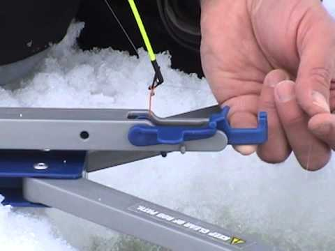 How to set up the jawjacker hook setter when ice fishing for Homemade ice fishing tip ups