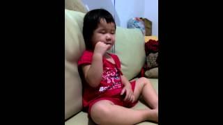 My cute sleepy daughter eat a slice of apples