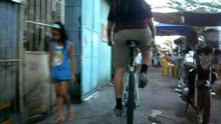 Bicycle riding in Manila on a narrow way