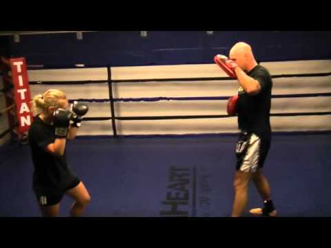 Women's kickboxing (boxing pad training) Image 1