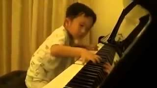Mozart returned, reincarnation, a 4-year boy playing the piano virtuoso