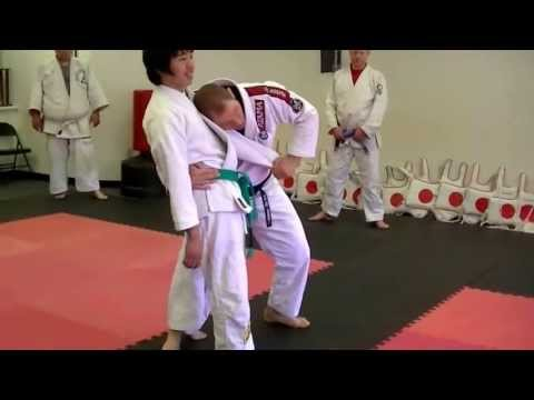 26May'13_TAKEDOWN 1.1: Grip Break to Modified Tani Otoshi (Rear Drop) Image 1