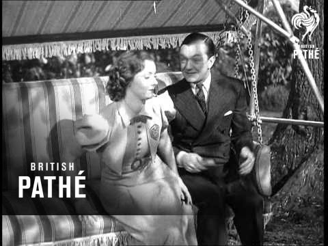 Bobby Howes sings 'You Give Me Ideas' to Rene Ray while sitting on a swing seat (1938)