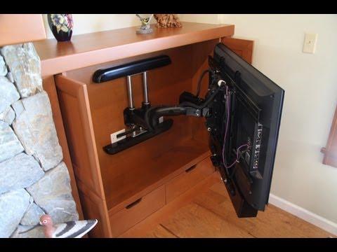 TV hidden beside fireplace - YouTube