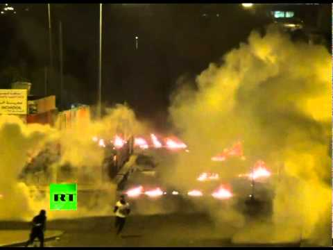 Bahrain petrol bomb inferno: Video of violent clashes after protester funeral