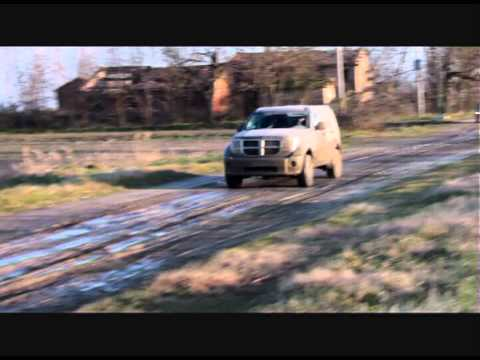 DODGE NITRO and NISSAN NAVARA off road in the mud