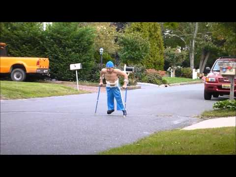 Walking with leg braces and crutches outside (Wheelchair user) (Paraplegic)