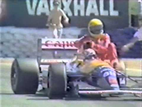 Senna runs out of fuel on the last lap as Mansell wins in Britain. Mansell pulls over to give Senna a lift back to the pits.