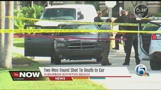 Two men found shot to death in car