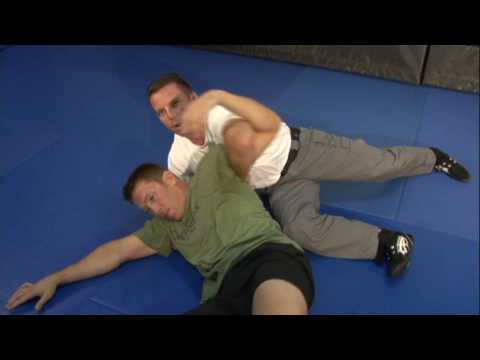 POLICE DEFENSIVE TACTICS: ARM DRAG TO REVERSE SCISSOR SWEEP FROM