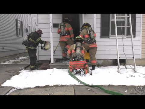 Arrival Video: firefighters stretching in on a house fire  03/12/17
