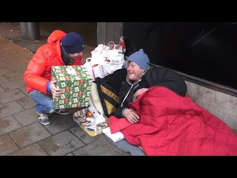 Giving Out Food And Presents To Homeless On Christmas Eve