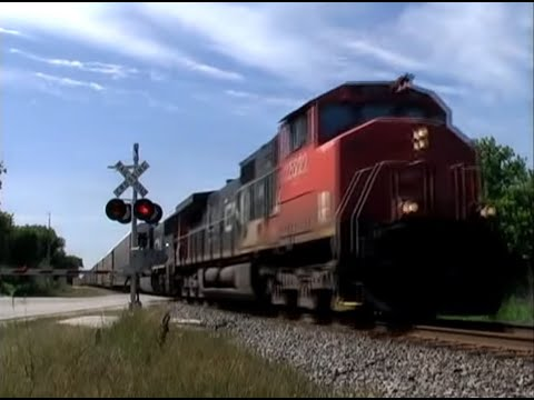 At the request of several people, I went back to the Honey Creek Road railroad crossing for a follow up video. CN 2522 and CN 5635 pull a northbound mixed fr...