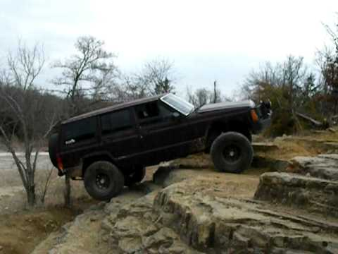 Me in my Jeep climbing a steep rock obstacle at Camp Gruber ORV Park near Braggs, OK.