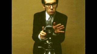 Watch Elvis Costello No Action video