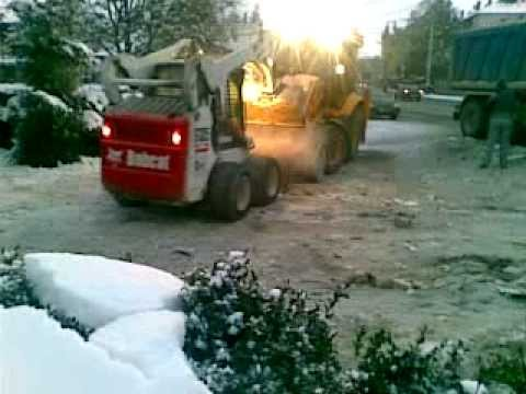 jcb 3cx backhoe and bobcat s185 skid steer at work