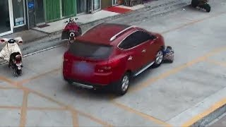 Reckless driver runs over boy and nearly again in reverse