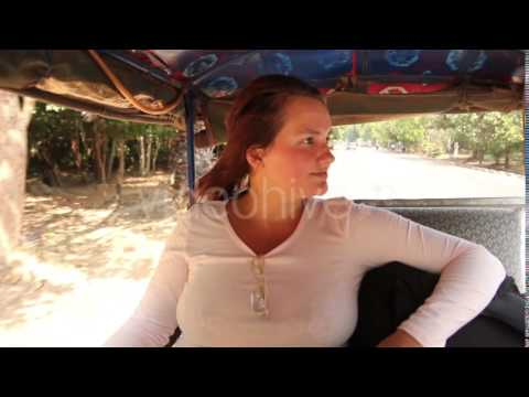 Beautiful Woman Travelling In Taxi Asia