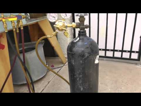 Nitrogen Tank Hooked Up To A Manifold Gauge Set Why